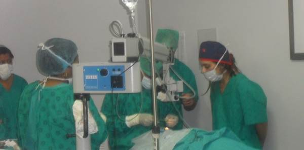 Doctors & Nurses At Theatre During Cataract Operation